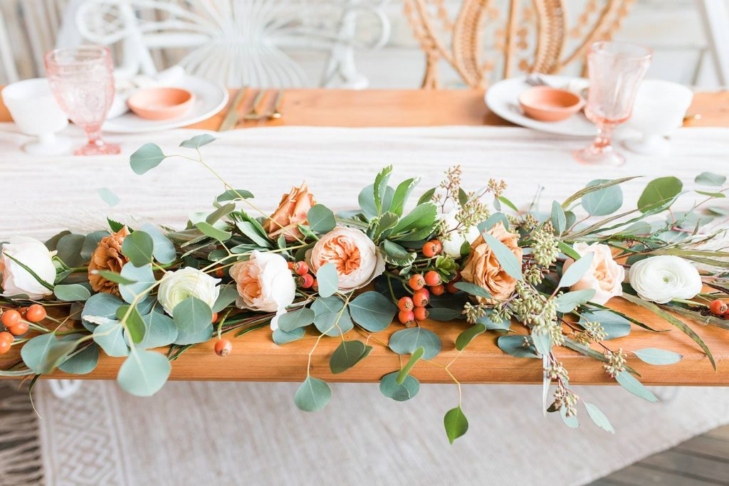 peach colored flowers on table