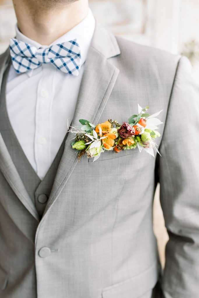 grooms suit with flowers in pocket