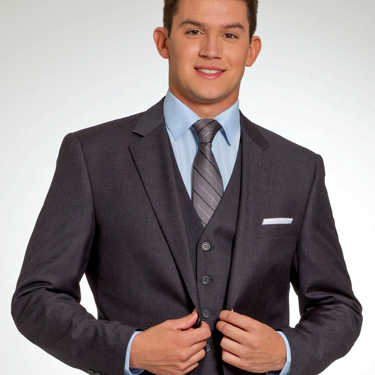 gentleman in a dark charcoal purchase suit