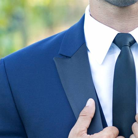 blue tuxedo with black satin lapel and black tie