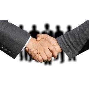 two men hand-shaking