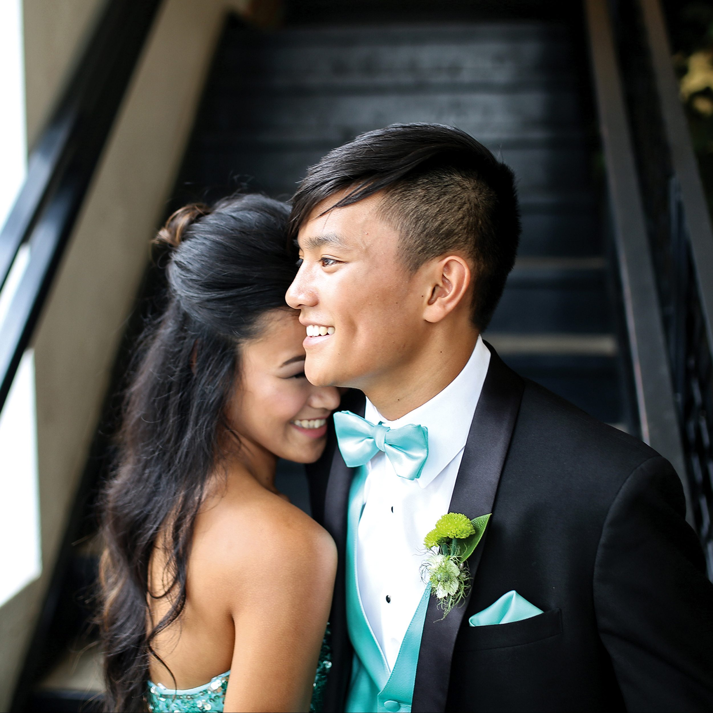 high school male and female wearing black tuxedo and teal dress