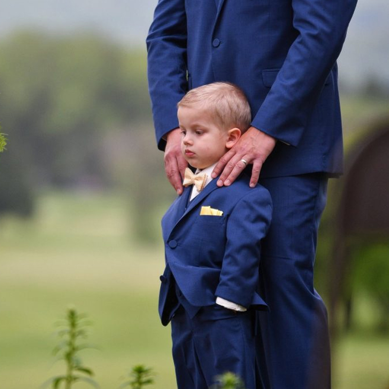 boy and father on wedding day in matching tuxedos